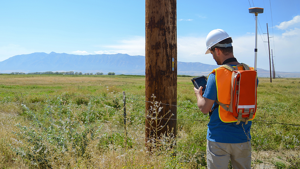 Man Inspecting and marking Utility Pole location using Mesa Geode and Uinta